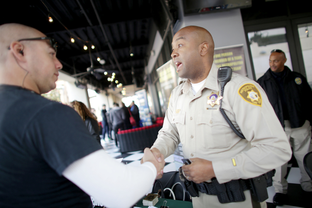 Metro Recruiter Larry Douglas shakes hands with Nicklas Rowland at the All County Law Enforcement Agencies Recruiting Expo on Sunday, Jan. 8, 2017, at Town Square in Las Vegas. (Rachel Aston/Las V ...