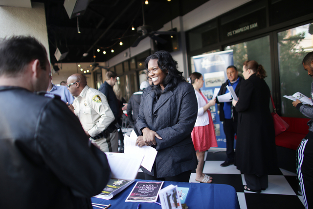 Metro Recruiter Erica Page talks to people at the All County Law Enforcement Agencies Recruiting Expo on Sunday, Jan. 8, 2017, at Town Square in Las Vegas. (Rachel Aston/Las Vegas Review-Journal)  ...