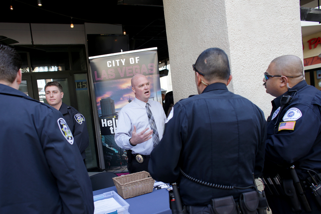 Deputy City Marshal Sergeant Matthew Triplett talks to officers at the All County Law Enforcement Agencies Recruiting Expo on Sunday, Jan. 8, 2017, at Town Square in Las Vegas. (Rachel Aston/Las V ...