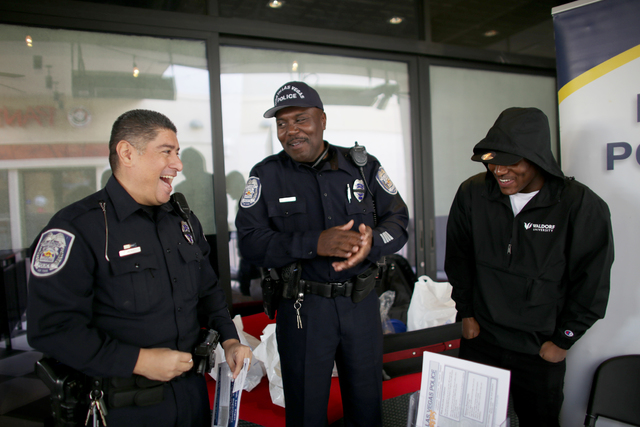 North Las Vegas Officer Teodoro Mendez Jr., left, North Las Vegas Officer Terry Graham and his son Tyrique Graham chat at the All County Law Enforcement Agencies Recruiting Expo on Sunday, Jan. 8, ...