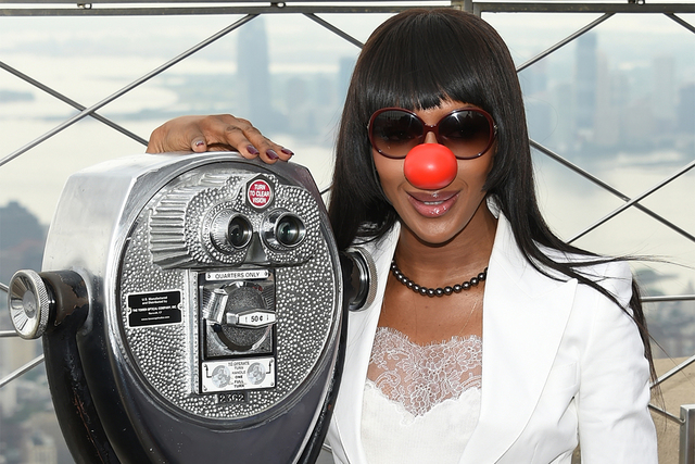 Model Naomi Campbell poses on the observatory of the Empire State Building in honor of Red Nose Day in New York last year. Comic Relief Inc. announced Thursday that 2017 fundraising efforts will c ...