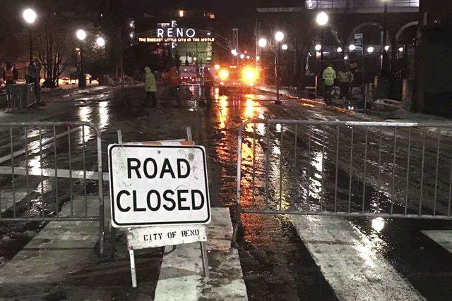 City of Reno crews close flood-prone roads and bridges in Northern Nevada late Saturday, including the Lake Street bridge over the Truckee River by the old Reno Arch in downtown Reno, Nevada. (Sco ...