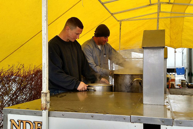 Inmates prepare the outdoor kitchen in Carson City to feed 260 inmates who are arriving from all over the state to help with flood preparation. (Nevada Department of Corrections)