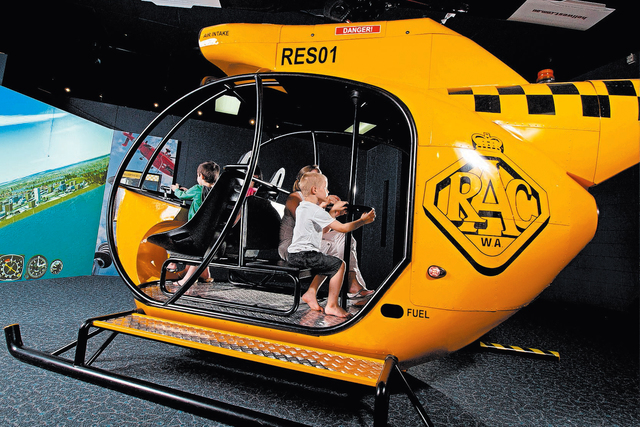 "A life-sized helicopter simulator is one of the interactive attractions of ""Rescue,"" which opens Saturday at the Discovery Children's Museum. (Courtesy Discovery Children&#x20 ..."