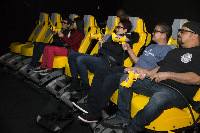 Bryan Fernandez, from right, his son Bryson and wife Leila experience the XD Dark Ride at GameWorks in Town Square on Friday, Dec. 30, 2016, in Las Vegas. Erik Verduzco/Las Vegas Review-Journal Fo ...