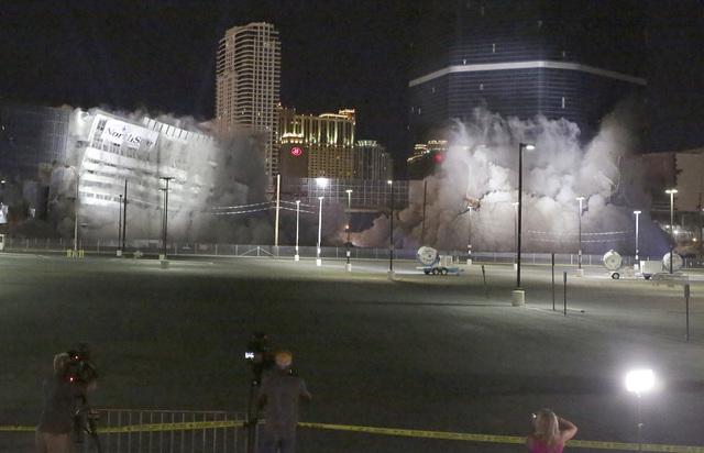 Smoke covers the area after the final tower of the Riviera hotel-casino come tumbling down during an implosion on Tuesday, Aug. 16, 2016, to make way for the Las Vegas Convention Center. Bizuayehu ...