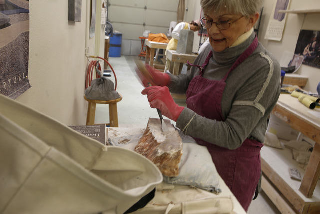 Susan Weintz, 73, begins shaping a rough piece of stone with a hammer and chisel at Sharon Gainsburg's studio. Weintz has mainly created abstract sculptures. (Christian K. Lee/Las Vegas Review-Jou ...