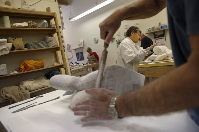 Most of Sharon Gainsburg's students spend three hours, once a week working on their stone carvings. Some students spend a year working on a single sculpture. (Christian K. Lee/Las Vegas Review-Jou ...
