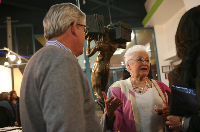 Artist Sharon Gainsburg talks with attendees during a reception for the Rock Stars III sculpture exhibition. Gainsburg came to stone carving after years of sculpting with clay. (Chase Stevens/Las  ...