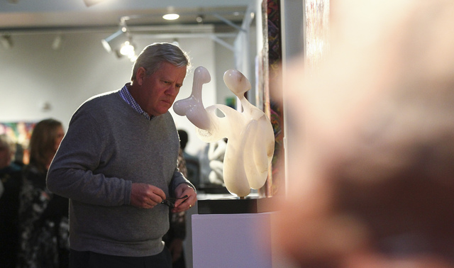 "Brooks Pierce looks at ""Family"" by Ronnie Tee Smith during a reception for the Rock Stars III exhibition. The exhibition features the work of sculptor Sharon Gainsburg and her students. (Chase Ste ..."