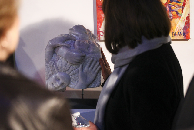 "Attendees look at ""Reflection"" by Doug Clark during a reception for the Rock Stars III sculpture exhibition at the Metropolitan Gallery in downtown Las Vegas. Students with as little as one year o ..."