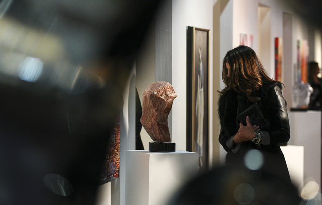 Marian Pierce looks at a sculpture during a reception for the Rock Stars III exhibition at the Metropolitan Gallery in downtown Las Vegas on Thursday, Jan. 26, 2017. Nearly 200 people attended the ...