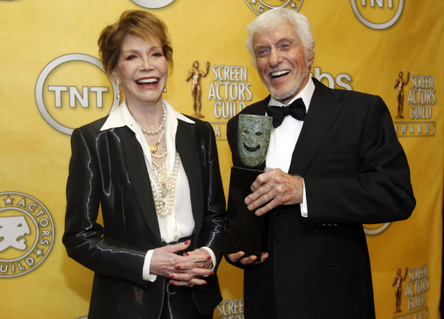 Actress Mary Tyler Moore poses backstage after accepting the Lifetime Achievement Award from presenter Dick Van Dyke at the 18th annual Screen Actors Guild Awards in Los Angeles, California Januar ...