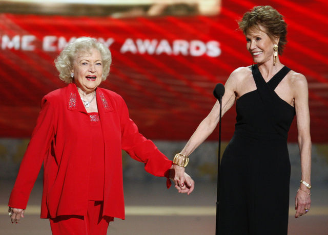 Actresses Betty White (L) and Mary Tyler Moore present the award for outstanding comedy series at the 60th annual Primetime Emmy Awards in Los Angeles September 21, 2008. (Lucy Nicholson/Reuters)
