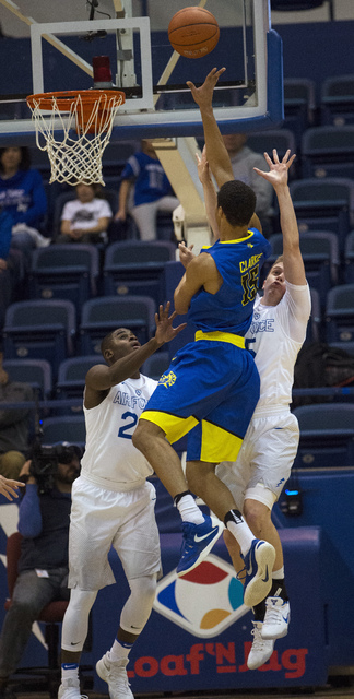 San Jose State guard Brandon Clarke goes up for a shot against Air Force guards Trevor Lyons, left, and Jacob Van during the first half of an NCAA college basketball game Saturday, Jan. 14, 2017,  ...