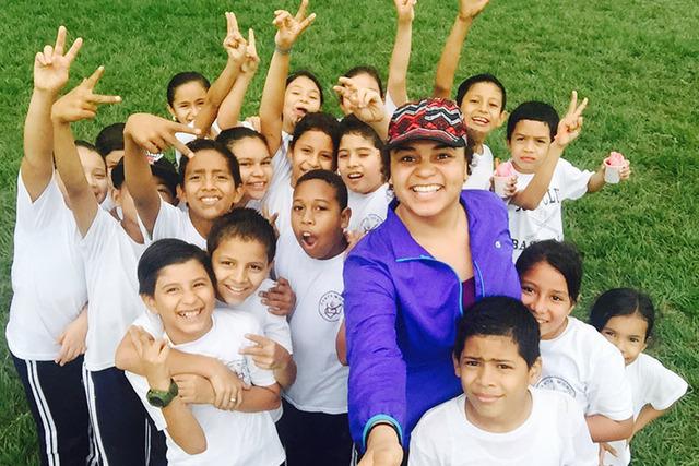 Haley Johnson takes a selfie Jan. 29, 2016, with students celebrating an annual field day at Santa Monica Bilingual School in Vida Nueva Cortes, Honduras, where she was a teacher. (Haley Johnson)