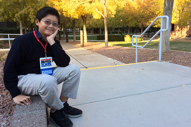 Alex Wong sits on the campus of The Meadows School after school Dec. 6, 2016 wearing his press badge. Wong has been selected as one of 24 Kid Reporters by Scholastic Magazine. As part of the News  ...