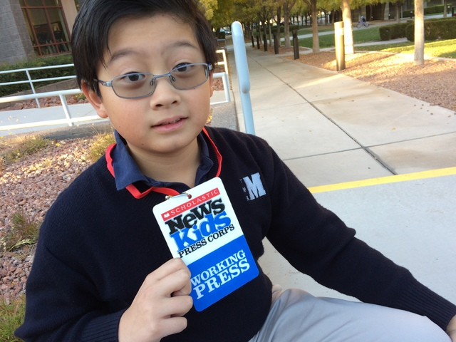 Alex Wong sits on the campus of The Meadows School after school Dec. 6, 2016, holding up his press badge from Scholastic Magazine. Wong has been selected as one of 24 Kid Reporters by the publicat ...