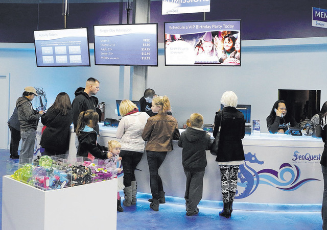 Visitors arrive at the Boulevard Mall's new SeaQuest Interactive Aquarium on its grand-opening day.(Bizuayehu Tesfaye/Las Vegas Review-Journal)@bizutesfaye