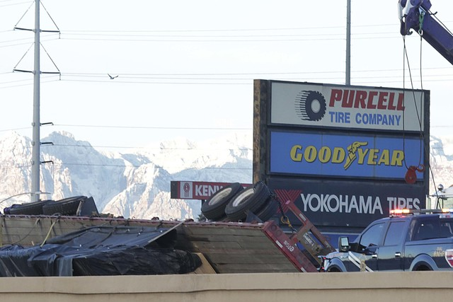 A semitrailer, which is transporting plywood, is on its side blocking an Interstate 15 on-ramp from Cheyenne Avenue, Tuesday, Jan. 24, 2017, in Las Vegas. (Bizuayehu Tesfaye/Las Vegas Review-Journ ...