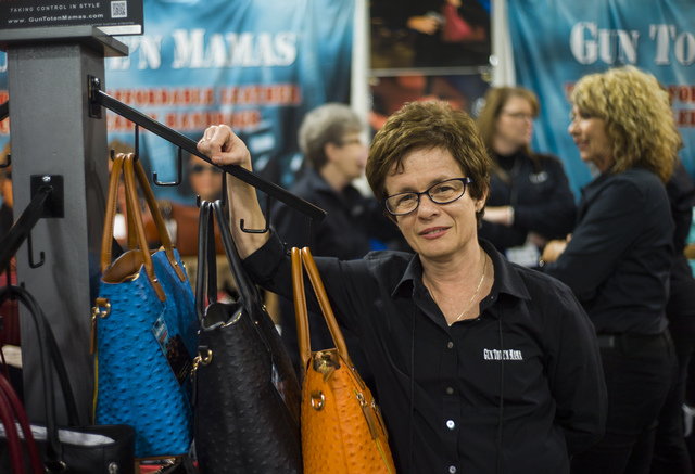 Claudia Chisholm, founder of Gun Tote'n Mamas, which sells concealed-carry handbags, during SHOT Show at the Sands Expo and Convention Center in Las Vegas on Thursday, Jan. 19, 2017. (Chase Steven ...