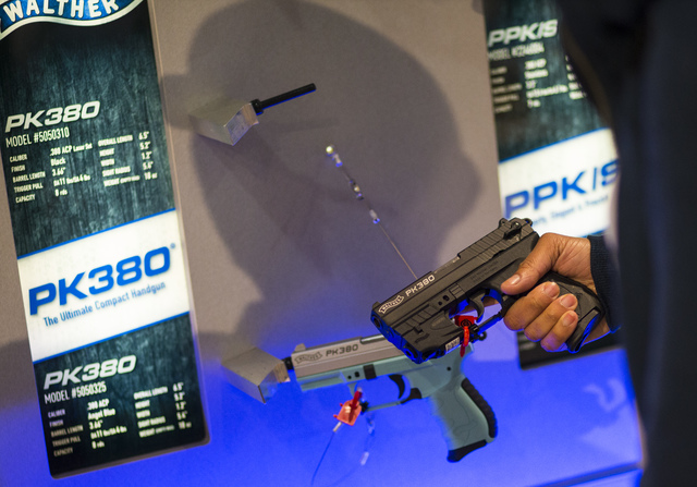Sherrone McCareins of Texas holds a Walther PK380 during SHOT Show at the Sands Expo and Convention Center in Las Vegas on Thursday, Jan. 19, 2017. (Chase Stevens/Las Vegas Review-Journal) @csstev ...