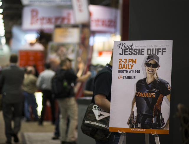 A sign advertises a meet and greet with sports shooter Jessie Duff at the Taurus booth during SHOT Show at the Sands Expo and Convention Center in Las Vegas on Thursday, Jan. 19, 2017. (Chase Stev ...