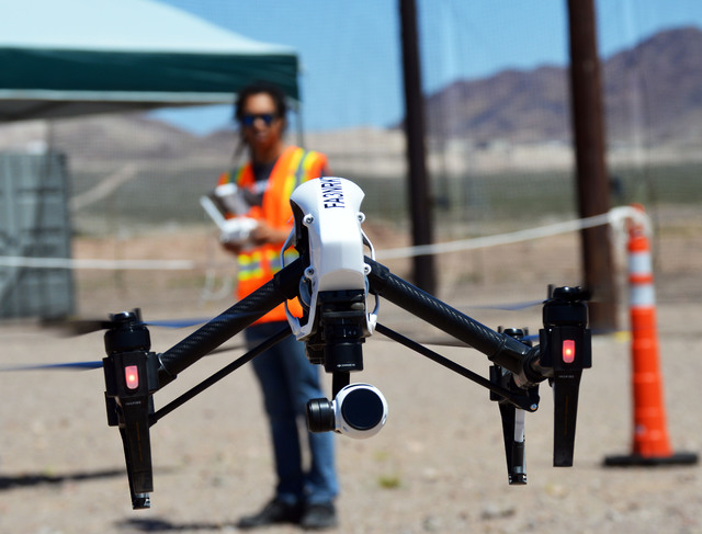 Mark Belizario films the Aerodrome port in Eldorado Valley using his DJI Inspire drone. The unmanned aerial vehicle is equipped with a high-tech 1,800 megapixel camera. Max Lancaster/Boulder City  ...