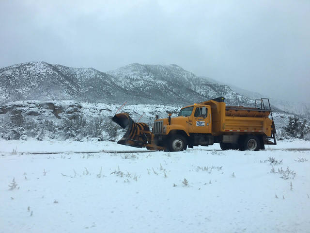Nevada Department of Transportation snow plows in action on the way to Mount Charleston. (Kimber Laux/Las Vegas Review-Journal)