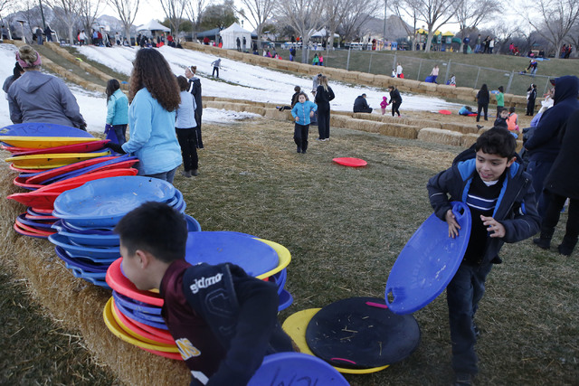 Kids rush up a hill to sled at the Arbors Tennis and Play Park on Saturday, Jan. 28, 2017, in Las Vegas. The park offered sledding and other activities to the visitors. (Christian K. Lee/Las Vegas ...
