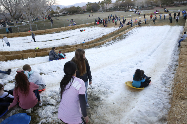 Kids slide down a hil at the Arbors Tennis and Play Park on Saturday, Jan. 28, 2017, in Las Vegas. The park offered sledding and other activities to the visitors. (Christian K. Lee/Las Vegas Revie ...