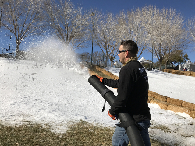 Brian Zarra, of IceNow, sprays snow on the hill at Arbors Park for Summerlin's Snow Day event from 1 to 5 p.m. Saturday, Jan. 28, 2017. Keith Rogers/Las Vegas Review-Journal