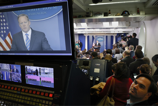 White House Press secretary Sean Spicer is seen on television broadcast monitors as he speaks to the media during the daily briefing in the Brady Press Briefing Room of the White House in Washingt ...