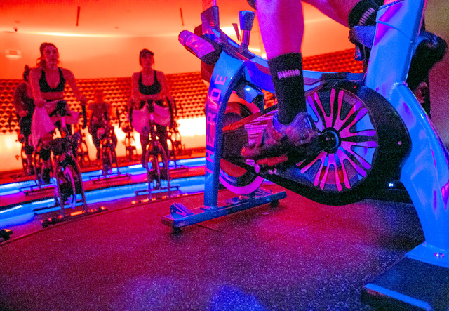 Instructor Patrick Leahy, right, conducts a spin class Monday, Dec. 19, 2016, at The Ride Premium Indoor Cycling, 4245 S. Grand Canyon Drive in Las Vegas. (Jeff Scheid/Las Vegas Review-Journal) @j ...
