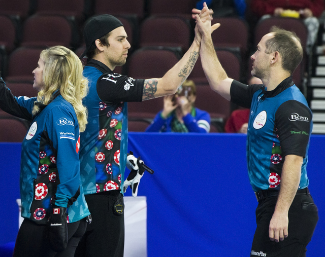 Jennifer Jones, left, and husband Brent Laing, right, greet fellow competitors before the start of the 2017 World Financial Group Continental Cup on Friday, Jan. 13, 2017, at Orleans Arena, in Las ...