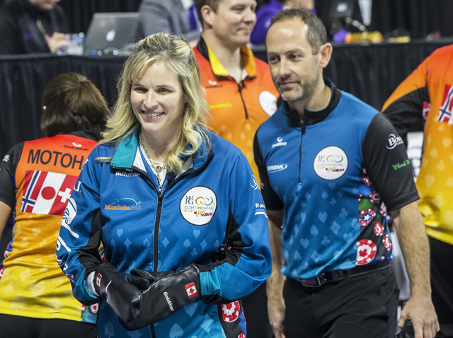 Jennifer Jones, left, and husband Brent Laing walk onto the ice before the start of the 2017 World Financial Group Continental Cup on Friday, Jan. 13, 2017, at Orleans Arena, in Las Vegas. (Benjam ...