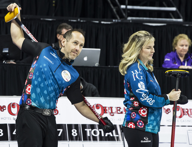 Brent Laing, left, and wife Jennifer Jones warm up before the start of the 2017 World Financial Group Continental Cup on Friday, Jan. 13, 2017, at Orleans Arena, in Las Vegas. (Benjamin Hager/Las  ...