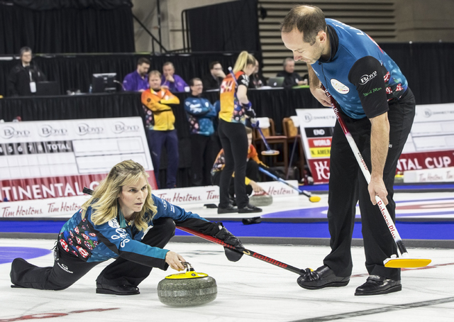 Jennifer Jones, left, and husband Brent Laing sweep down the ice during the 2017 World Financial Group Continental Cup on Friday, Jan. 13, 2017, at Orleans Arena, in Las Vegas. (Benjamin Hager/Las ...