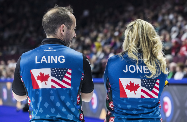 Jennifer Jones, right, and husband Brent Laing talk strategy during the 2017 World Financial Group Continental Cup on Friday, Jan. 13, 2017, at Orleans Arena, in Las Vegas. (Benjamin Hager/Las Veg ...