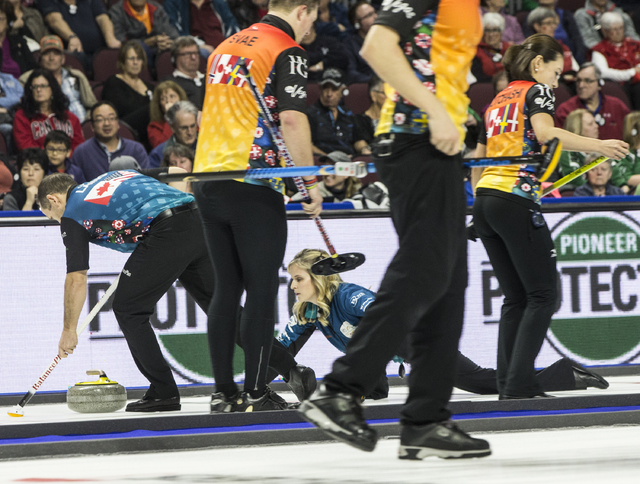 Jennifer Jones, middle, and husband Brent Laing, left, compete in the 2017 World Financial Group Continental Cup on Friday, Jan. 13, 2017, at Orleans Arena, in Las Vegas. (Benjamin Hager/Las Vegas ...