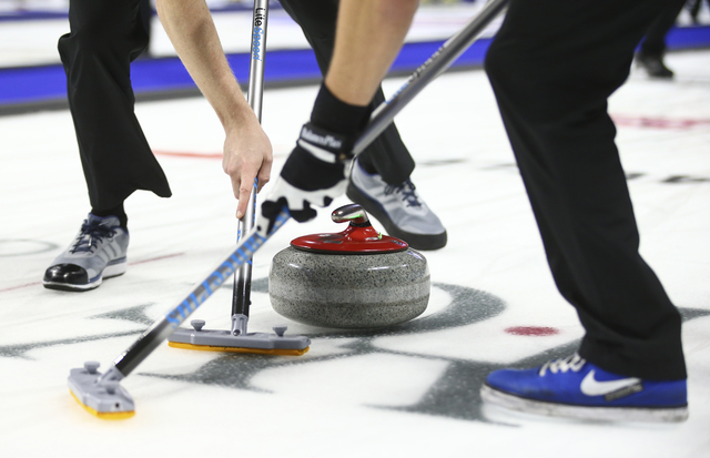 Team North America's Tom Howell, left, and Korey Dropkin sweep ahead of the rock during the WFG Continental Cup curling championship at the Orleans Arena in Las Vegas on Thursday, Jan. 12, 2017. ( ...