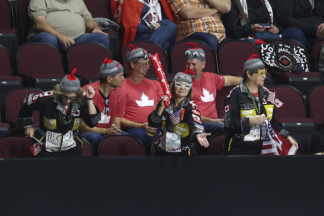 Curling fans dance during the opening ceremony for the WFG Continental Cup at the Orleans Arena in Las Vegas on Wednesday, Jan. 11, 2017. (Chase Stevens/Las Vegas Review-Journal) @csstevensphoto