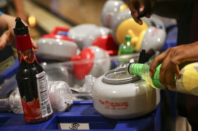 Attendees get curling stone-shaped drinking containers ahead of the opening ceremony for the WFG Continental Cup at the Orleans Arena in Las Vegas on Wednesday, Jan. 11, 2017. (Chase Stevens/Las V ...