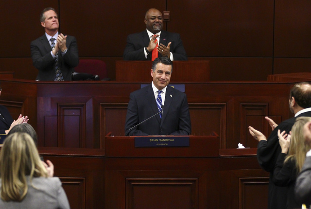 Nevada Gov. Brian Sandoval is applauded at the conclusion of his final State of the State address at the Legislative Building in Carson City on Tuesday, Jan. 17, 2017. (Chase Stevens/Las Vegas Rev ...