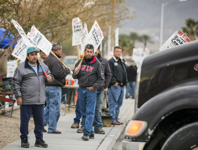 Teamsters Local 631 walk the picket line in front of Rinker Hydro Conduit, 2100 Burns Ave., in Henderson on Wednesday, Dec. 21, 2016. About 75 workers have been on strike for over a month for high ...