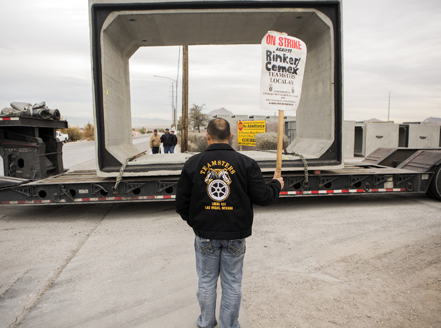 Danny Jackson with Teamsters Local 631 watches a semi-truck loaded with concrete conduit while it exits Rinker Hydro Conduit, 2100 Burns Ave., in Henderson on Wednesday, Dec. 21, 2016. Jeff Scheid ...