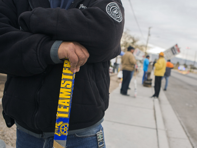 Welder Antonio Sosa with Teamsters Local 631 braces on a strike sign on the picket line in front of Rinker Hydro Conduit, 2100 Burns Ave., in Henderson on Wednesday, Dec. 21, 2016. Jeff Scheid/Las ...