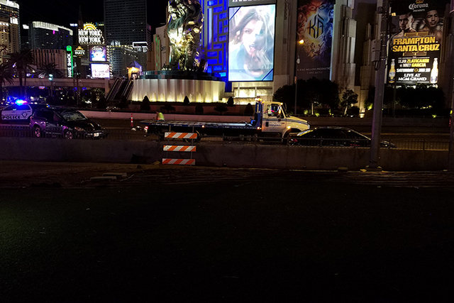 A rollover crash on East Tropicana Avenue across from the MGM Grand slowed traffic early Friday morning. (Mike Shoro/Las Vegas Review-Journal)