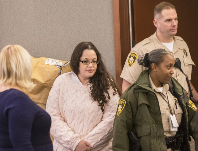 Brandy Stutzman, middle, enters the courtroom during closing arguments in her death penalty murder trial on Friday, Jan. 27, 2017, at the Regional Justice Center, in Las Vegas. Stutzman is charged ...