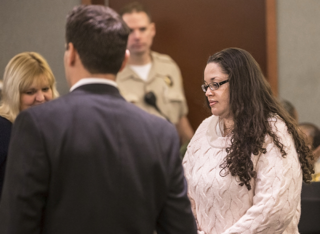 Brandy Stutzman, right, enters the courtroom during closing arguments in her death penalty murder trial on Friday, Jan. 27, 2017, at the Regional Justice Center, in Las Vegas. Stutzman is charged  ...